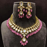 Oval And Leaf Kundan Necklace