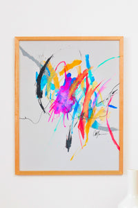 Abstract painting with a beautiful balance of negative space and vibrant colors. Pops of bright blue, hot pink, green and yellow are balanced with white space and black lines. Energy of paintig travels from top left corner to right middle.  Framed with a small white mat and brown wooden frame.