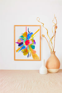 Simple, minimalist space highlighting a framed painting. Painting includes bright colors and organic, loose shapes, and geometric gold shapes. Also includes small black lines and negative space around the pop of color.
