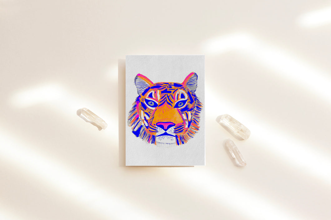 Colorful tiger card featuring tiger's head, organic blue, pink and orange watercolor strokes  Playful and powerful design on a slightly textured paper. Card surrounded by beautiful crystals.