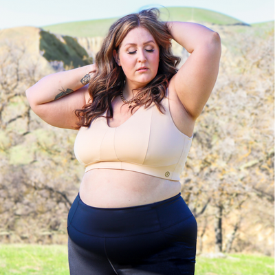 Model wearing Freedom Bra in champagne color, 4xl size