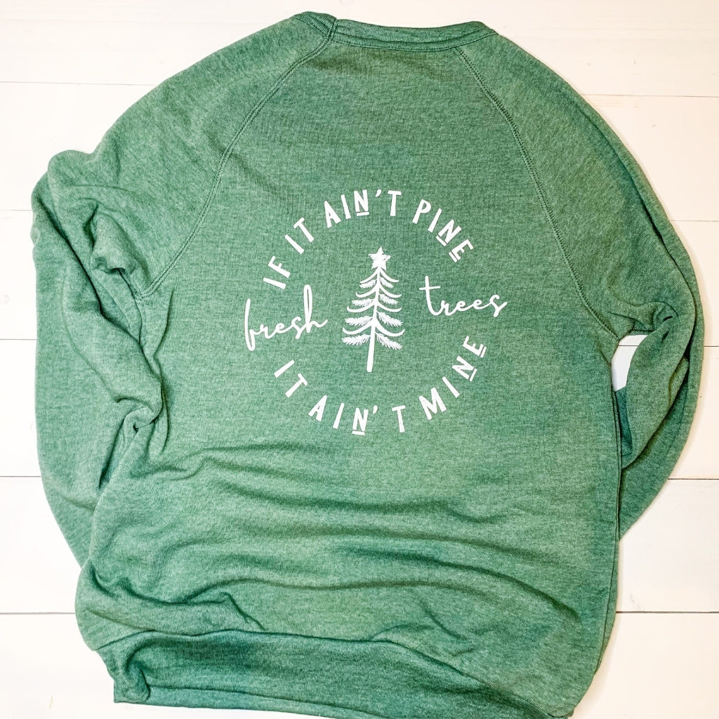 christmas crewneck sweatshirts for men and women.  vintage christmas sweatshirts.  womens holiday sweatshirts in green.  christmas tree sweatshirt.  super soft fleece crewneck sweatshirt.  womens nature sweatshirt.  green sweatshirt for christmas.  white screen printed ink in a circle design on the back of the sweatshirt.