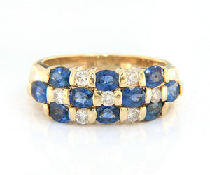 1.80ctw Oval Ceylon Sapphire and 0.45ctw Diamond Channel Set Three Row Band Ring