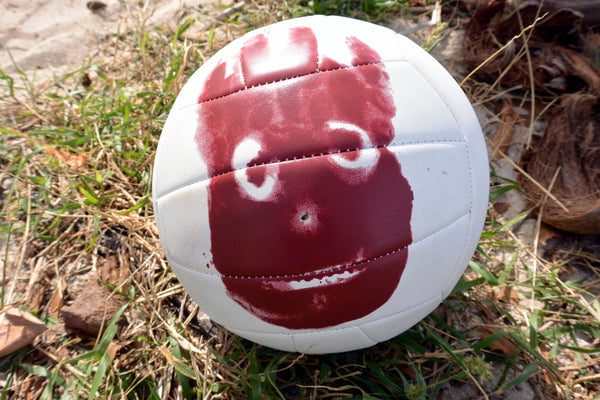 Wilson the volleyball in Cast Away, tom hanks cast away, wilson tom hanks imaginary friend
