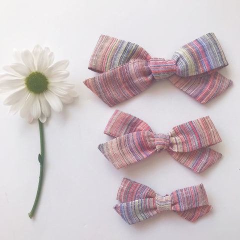 Linen rainbow stripes bow in mini medium large pigtails on baby nylon headband or kids toddler hair clips pride rainbow baby natural