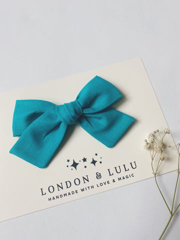 Turquoise solid cotton bows
