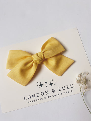 Buttercup solid cotton bows