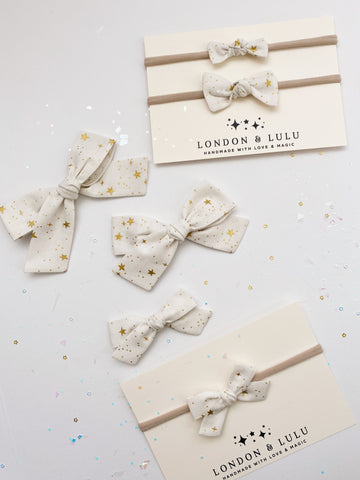 Rifle paper co white & metallic gold stars bows
