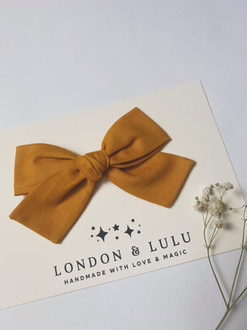 Mustard solid cotton bows
