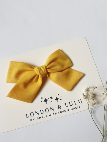 Daisy solid cotton bows