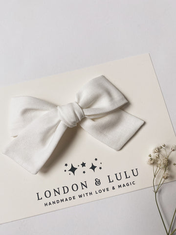 White solid cotton bows