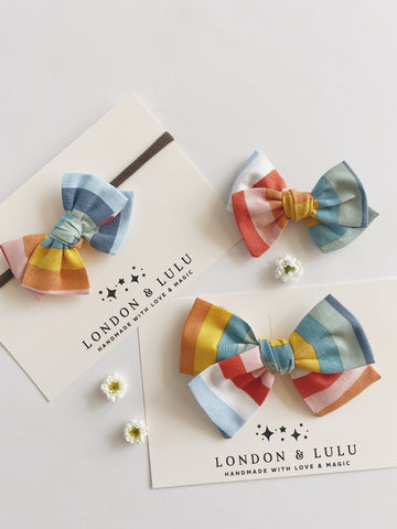 Muted natural rainbow stripe twirl bows