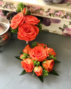 Corsage and boutonnière in orange