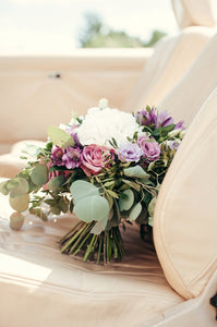 Bridal and prom bouquet with white hydrangea,  purple roses and lisianthus.