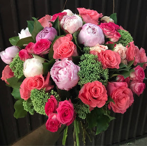 Beautiful bouquet of pink peonies and roses