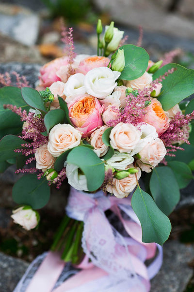 Bridal and prom bouquet  with Austin`s roses,  freesia, astilbe and lisianthus.