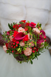 Bridal and prom bouquet with red mini roses, callas, berries.