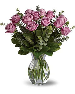Romantic roses with a lavender twist!  Includes:  Lavender roses, assorted greens Vase Free message card