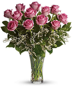 One dozen pink roses are gathered with white limonium and rich green salal in a classic trumpet vase she'll use again and again. Includes: Pink roses, white limonium, green salal. Vase Free message card