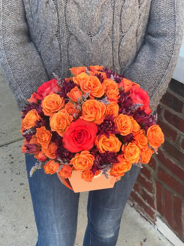 Celebrate the beauty of fall with this colorful, heartwarming mix flowers, hand-delivered in our classic box.   Includes:  Orange mini roses, purple daisies, assorted greens. Box Free message card