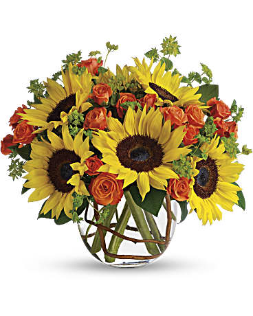 Brighten up a table, send get well wishes, or simply sprinkle sunshine on someone's day with this summer flower arrangement.  Includes:  Sunflowers, orange mini roses, assorted greens Vase Free message card