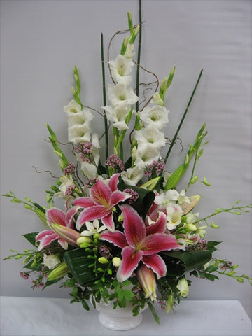 Funeral arrangement with pink lilies, orchids and gladiolus