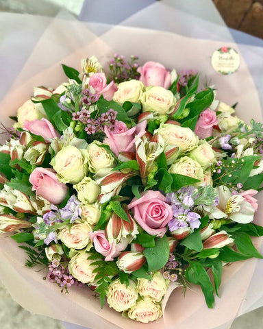 It's beauty-full!  This delightful pink arrangement brings spring joy to that special someone.  Includes:  Pink roses, creamy mini roses, white alstroemerias, lavender stock, pink wax flowers, fern. Wrapped in a craft paper Free message card