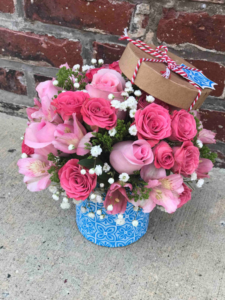 Sometimes all you need is a little pink me up! An ideal pick for anyone whose favorite color is pink, this stylish mix is full of variety and comes presented in a small box they'll use again and again.  Includes:  Pink roses and mini roses, babie`s breath, alstroemerias, assorted greens. Mini box Free message card