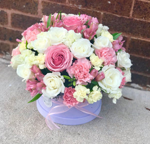 A stunning orchid flower box with vibrant flowers. The perfect gift for birthday, baby shower, wedding.  Includes:  Pink roses,white roses, pink alstroemerias, light yellow and green carnations. Velvet box Free message card