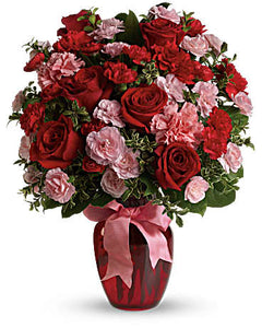 If you want to make a really big impression, surprise her with delivery to her office.   Includes:  Red roses, pink and red carnations, assorted greens. Vase Free message card