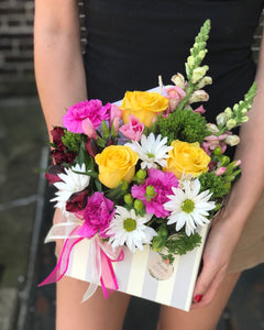 Featuring a wide, wondrous assortment of blooms in one bouquet, this colorful arrangement is always a favorite!   Includes:  Yellow roses, pink carnations, white daisies, pink snapdragons, red alstroemeria. Floral envelope Free message card