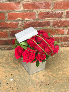 Remember the glorious feeling when you both starting falling in love? Fan the flame with this wildly romantic bouquet.   Includes:  Red roses, assorted greens. Box Free message card