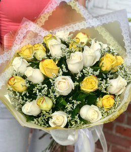 What a bright idea! Send a summery treat to someone special with this cheerful bouquet of two dozen yellow and white roses. A happy pick for your fellow yellow-lover!  Includes:  12 yellow roses, 12 white roses, limonium, assorted greens. Wrapped in a craft paper Free message card