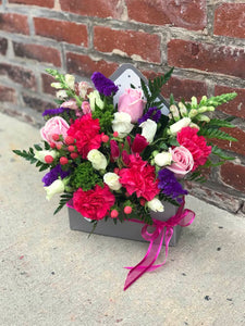 Show your romantic side by sending this gorgeous arrangement in a charming  envelope. She'll love the gift, and you for having such amazingly good taste. Includes: Hot pink carnations, pink roses, berries, snap dragons, purple stacice. Floral envelope. Free message card Available for same day delivery!