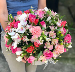 It's beauty-full! This delightful pink arrangement brings spring joy to that special someone.  Includes:  Pink roses, carnations and alstroemerias, berries, orchid. Velvet box Free message card