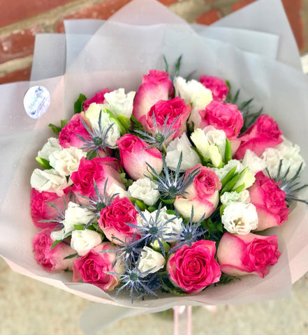 She may call this the prettiest bouquet she's ever received - for good reason!  Includes:  17 Pink roses, eringium, fern. Wrapped in a craft paper. Free message card