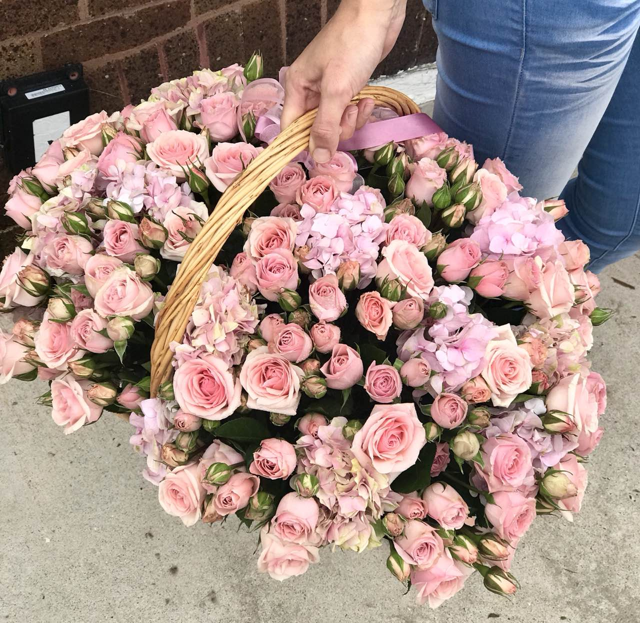 Welcome the newest little cutie into the world with this pink-tastic basket of roses and hydrangea.  Includes:  Pink mini roses, pink hydrangea. Basket Free message card