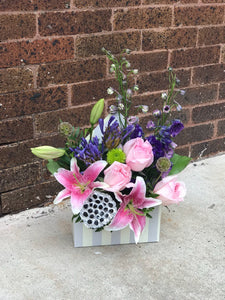Send her on a dreamy stroll through a garden with this perfect-for-any-occasion bouquet.   Includes:  Pink lilies and roses, blue delphinium Floral envelope Free message card Dried lotus