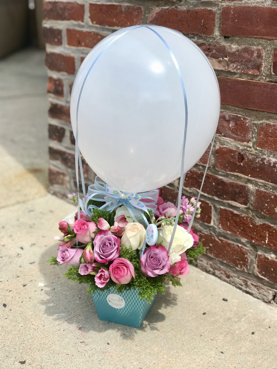 Celebrate a sweet boys's and girl`s arrival with this precious air balloon!  Includes:  Pink, white, lavender roses, pink alstroemeria, assorted greens. Box Balloon Free message card