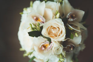 Bridal and prom bouquet with white orchids, roses and lisianthus.