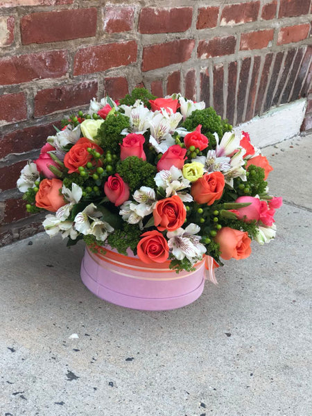 As warm and inviting as a day at the beach or summer sunrise, this invigorating arrangement of mouthwatering orange flowers is a gorgeous expression of your love or friendship.  Includes:  Orange roses, white alstroemerias, berries, assorted greens. Velvet box Free message card