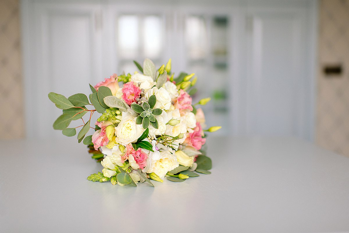 Bridal and prom bouquet with Austin`s roses,  freesia, succulent and lisianthus.