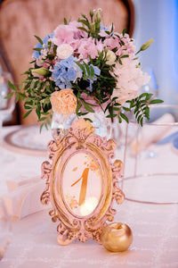 Centerpieces - whether large and spectacular or small and clustered. We love them all!  Includes:  Pink,white and light blue hydrangea, white lisianthus, creamy carnations,assorted greens. Vase