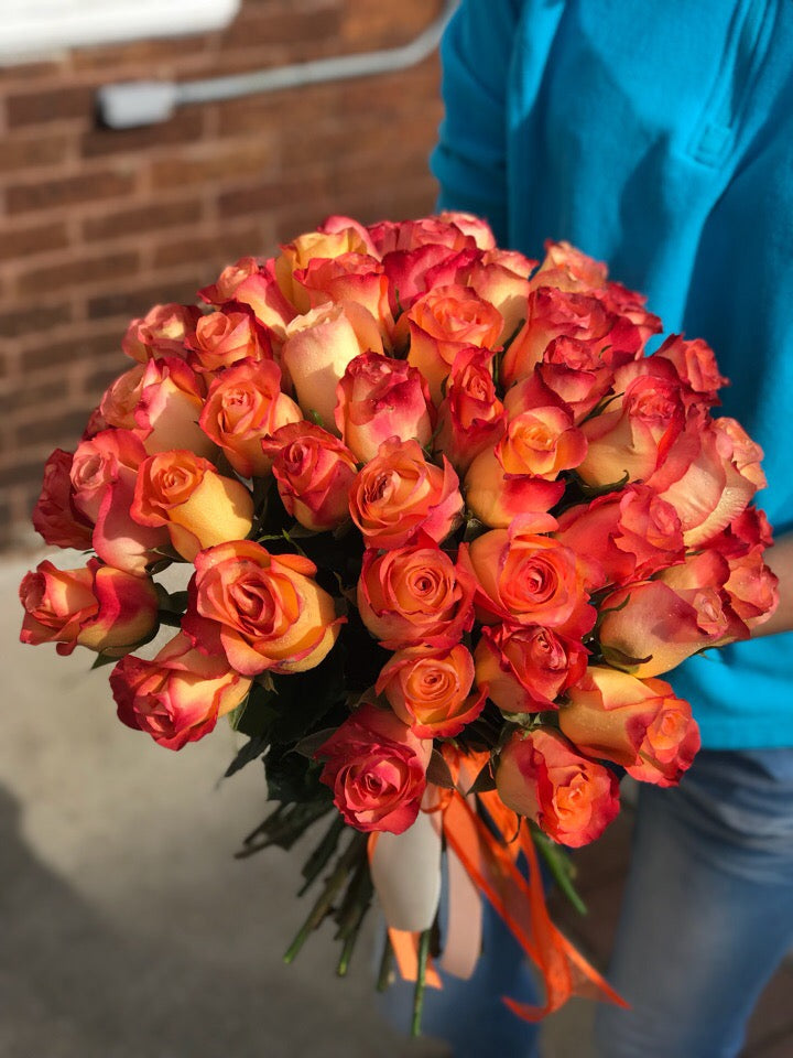 Brighten their home with the gift of sunshine! Since this cheerful bouquet is so affordable, why not bring sunshine indoors at your house, too?  Includes:  Fifty orange roses Free message card