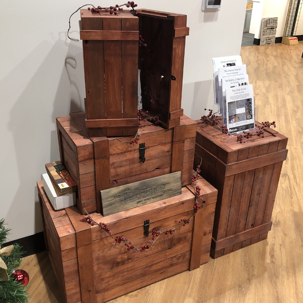 The rustic crate series 400 with a crimson stain set up as a christmas holiday display. Cranberries surround an acrylic brochure holder
