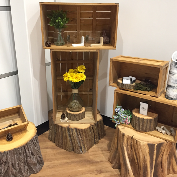Rustic box crates set up as display shelves for flowers and greenery. A very woodland theme
