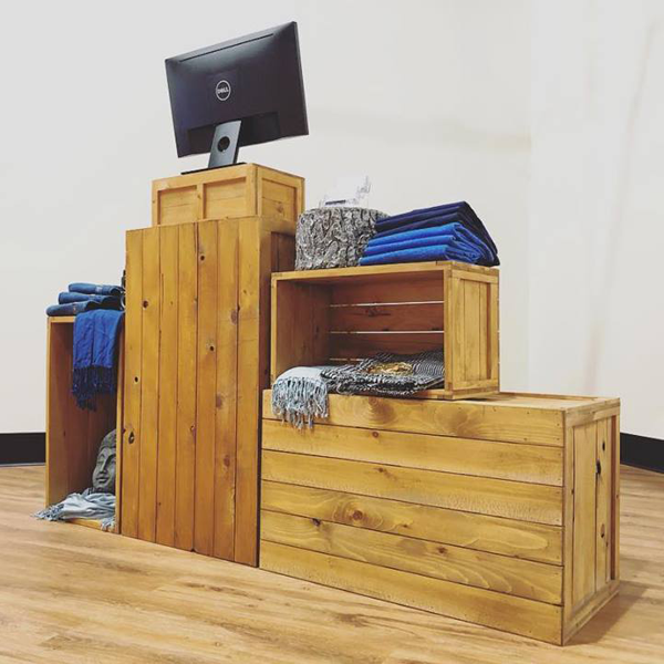 The rustic crate series 100 organised as a point-of-sale for pop-up retail and trade show exhibit for clothes and accessories