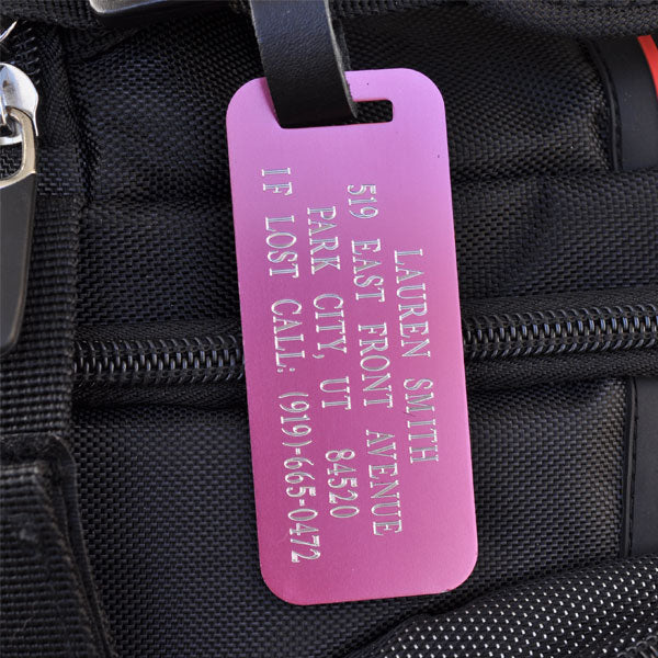 Make finding your bags at the baggage claim easier with this bright pink luggage tag. You can engrave a custom message of up to four lines of information, such as your name, email and phone number. Statistics show having a custom id tag on your luggage will help get it back to you faster in case of an emergency. This Pink Luggage Tag comes engraved with silver lettering and includes a black leather strap with a silver buckle.