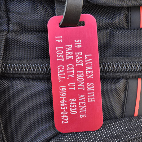 Secure your baggage with our Red Aluminum Luggage Tag with Leather Strap. Each of our Luggage tags are made with airplane grade aluminum, and will not add weight to your luggage! Our Luggage Tags each come with a beautiful 100% hand-made leather strap with a silver belt style buckle to securely attach to your baggage.