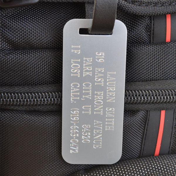 If you travel frequently and are in need of durable luggage tags, our silver luggage tag is made from a high quality aluminum and is engraved with a clear bold font so your information can be read easily. You can customize this tag with up to four lines of text. This silver id tag comes with a leather strap which has a matching silver buckle. Having Personalized luggage tags ensures that if your luggage is lost someone will know how to contact you.